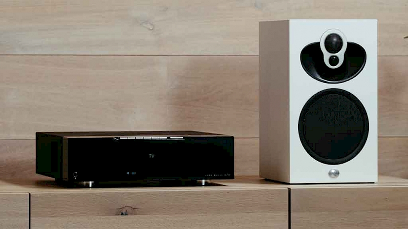 Linn  Majik DSM next to white Linn speaker on wooden shelf