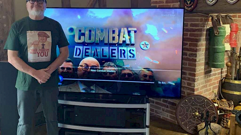 combat dealers host at home in front of his new tv