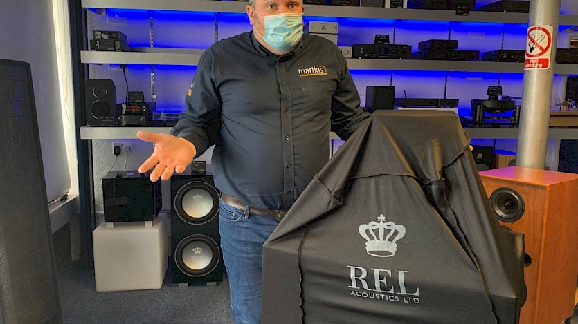 steve stood next mysterious rel package covered in black rel branded cover
